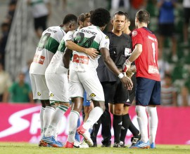 Elche's players argue with referee Muniz Fernandez during the Spanish league football match Elche vs Real Madrid at the Manuel Martines Valero Stadium in Elche on September 25, 2013.  AFP PHOTO / JOSE JORDAN        (Photo credit should read JOSE JORDAN/AFP/Getty Images)